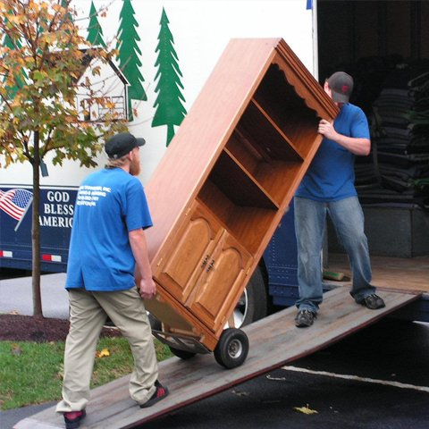Residential Moving crew taking cabinet into moving truck